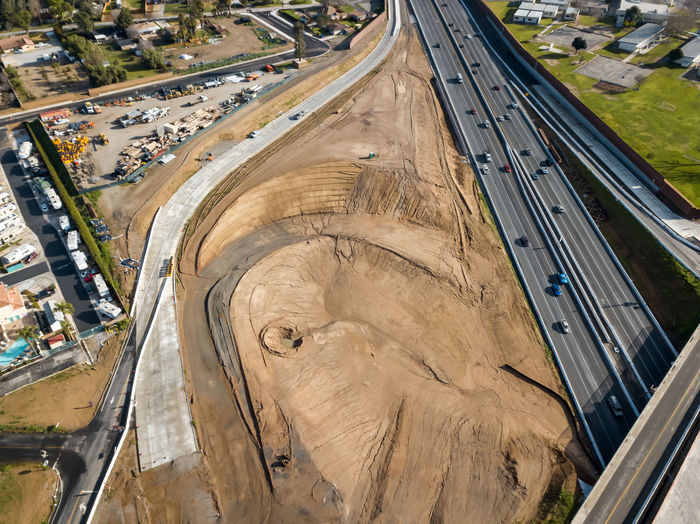 Grand Terrace, CA / USA - 2/16/2019: The Barton Road / 215 Interchange Under Construction Transportation Road High Angle View Mode Of Transportation Architecture City Land Vehicle Day Built Structure Building Exterior No People Outdoors Nature Roundabout Road Freeway Construction Development Bridge Concrete Asphalt