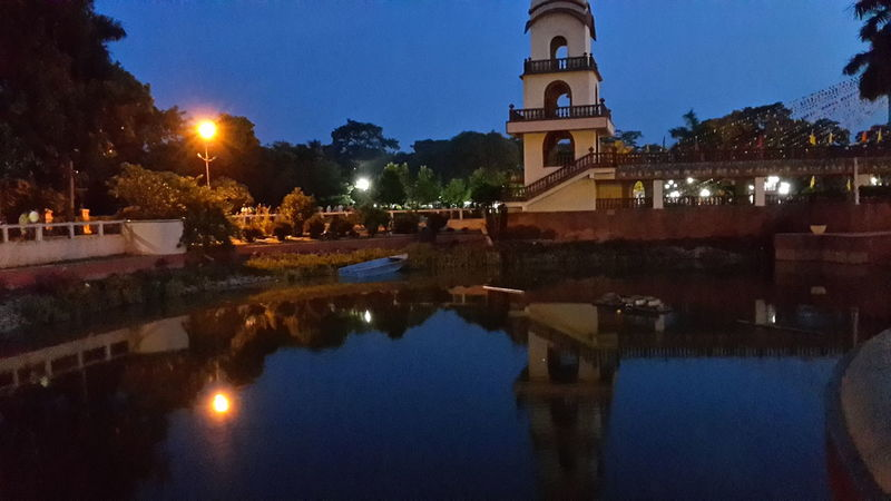 Architecture Building Exterior Built Structure City Cloud Cloud - Sky Cloudy Dusk Famous Place High Section International Landmark Lights Low Angle View Mayapur Night Lights Outdoors Overcast Reflection Religion Residential District Sky Sunset Tower Water Reflections