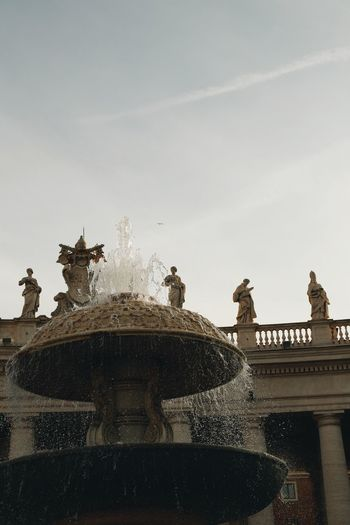 Low angle view of fountain against sky