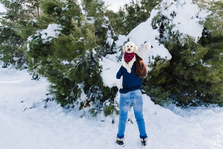 Portrait of woman standing in snow