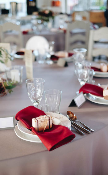 High angle view of plates and wineglasses on table