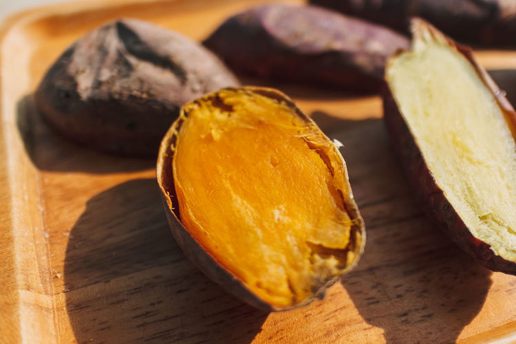 Close-up of orange slice on cutting board
