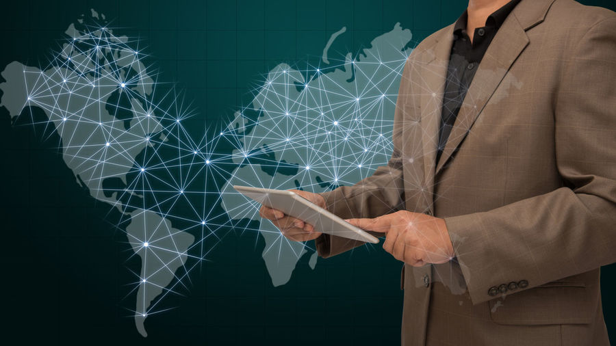 Digital composite image of businessman with world map
