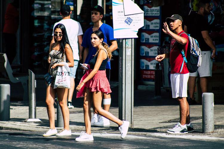Full length of women standing in city