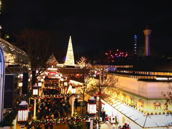Over-the-top view beim Tivoli in Kopenhagen. Night Christmas Illuminated Celebration Built Structure Architecture Building Exterior Large Group Of People Christmas Decoration Christmas Tree City Tradition Travel Destinations Outdoors Holiday - Event Christmas Market Crowd Real People Sky Tree EyeEmNewHere