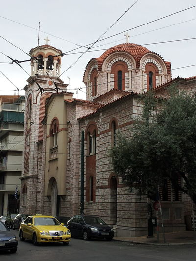Arch Architecture Building Exterior Built Structure Cable Car Church City City Life Clear Sky Day Greece Greece, Loutraki Historic In Route To Mount Apollo Land Vehicle Mode Of Transport Outdoors Power Line  Road Sky Spire  Street Tower Transportation
