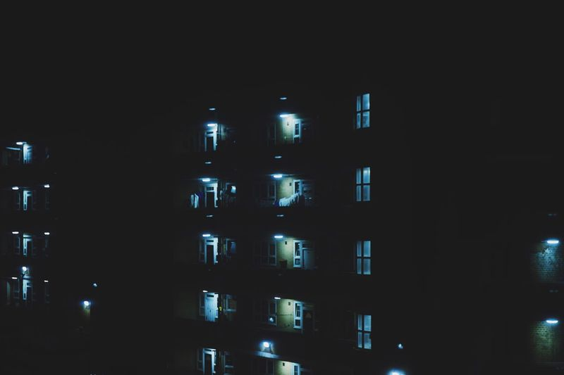 View of residential buildings at night