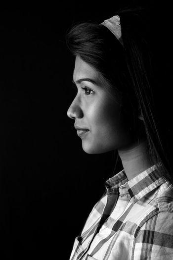 Young woman looking away in darkroom