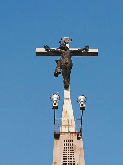 Cross Statue Crucifix Sculpture Religion Low Angle View Day Memorial No People Blue Clear Sky Jesus Christ Sky Outdoors Xperia Z5 XperiaZ5 Xperiaphotography XPERIA Sony Xperia Live For The Story The Street Photographer - 2017 EyeEm Awards BYOPaper! EyeEmNewHere INRI