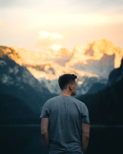 Rear view of young man looking at mountains
