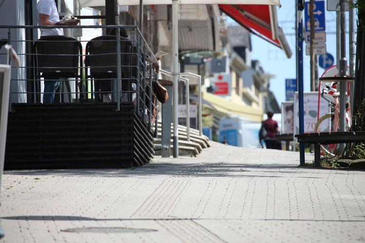 Footpath by street in city