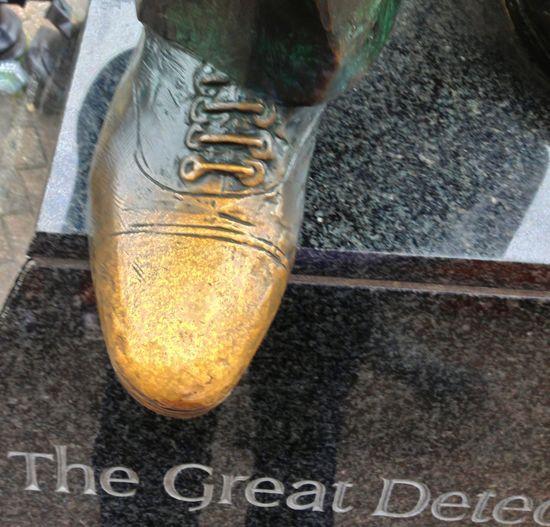 Walking Around Sherlock Holmes London's Streets Foot worn shiny by bottoms Sightseeing