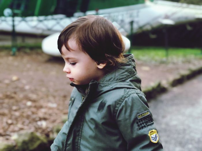 Portrait of cute boy standing outdoors