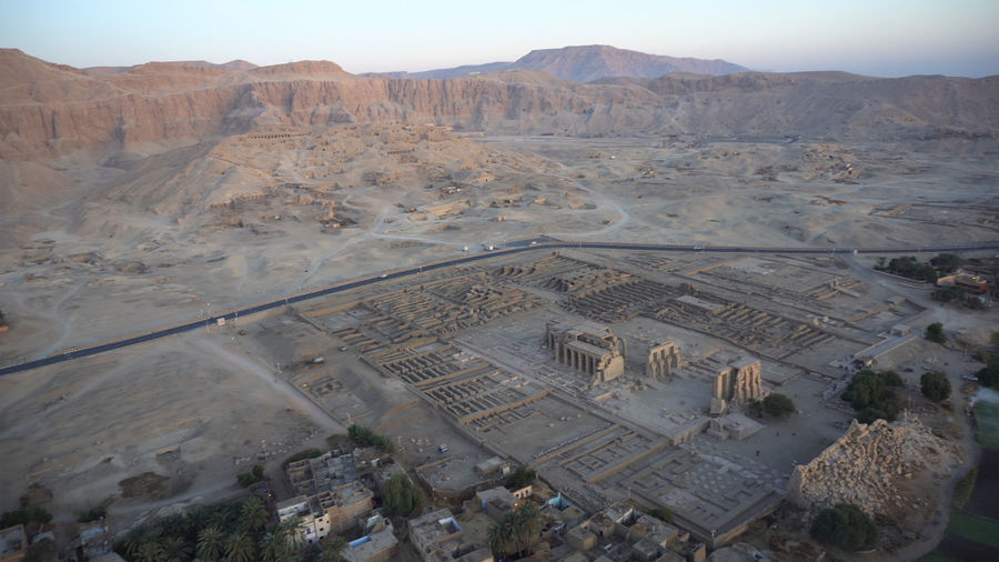 Aerial view medinet habu temple from hot air balloon with valley of the kings skyline luxor egypt