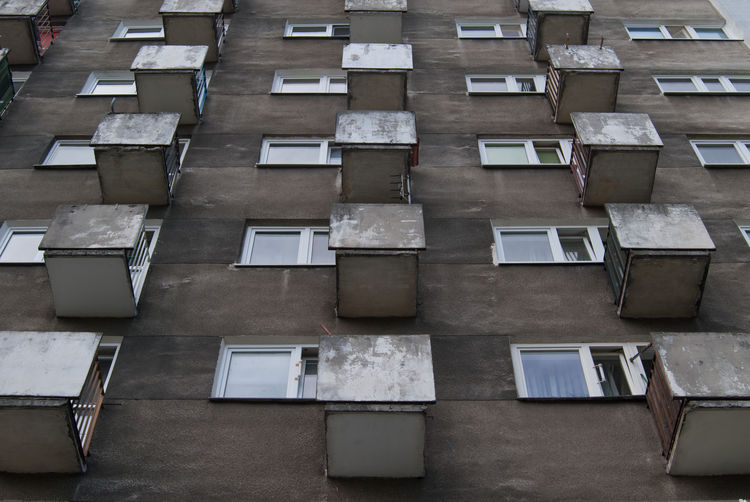 Residential Building from the communist era in Warsaw Built Structure Architecture Building Exterior Window Building Day Residential District No People In A Row Apartment Full Frame Outdoors Low Angle View Backgrounds Side By Side Repetition City Roof Nature Poland Warsaw Communist Architecture