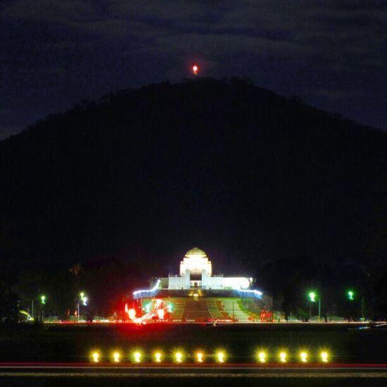 Mount Ainslie makes a dramatic night backdrop for the war memorial.
