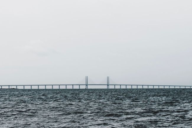 Bridge - Man Made Structure Sea Water Connection Copy Space Suspension Bridge Waterfront Built Structure Architecture Sky No People Transportation Bridge Horizon Over Water Clear Sky