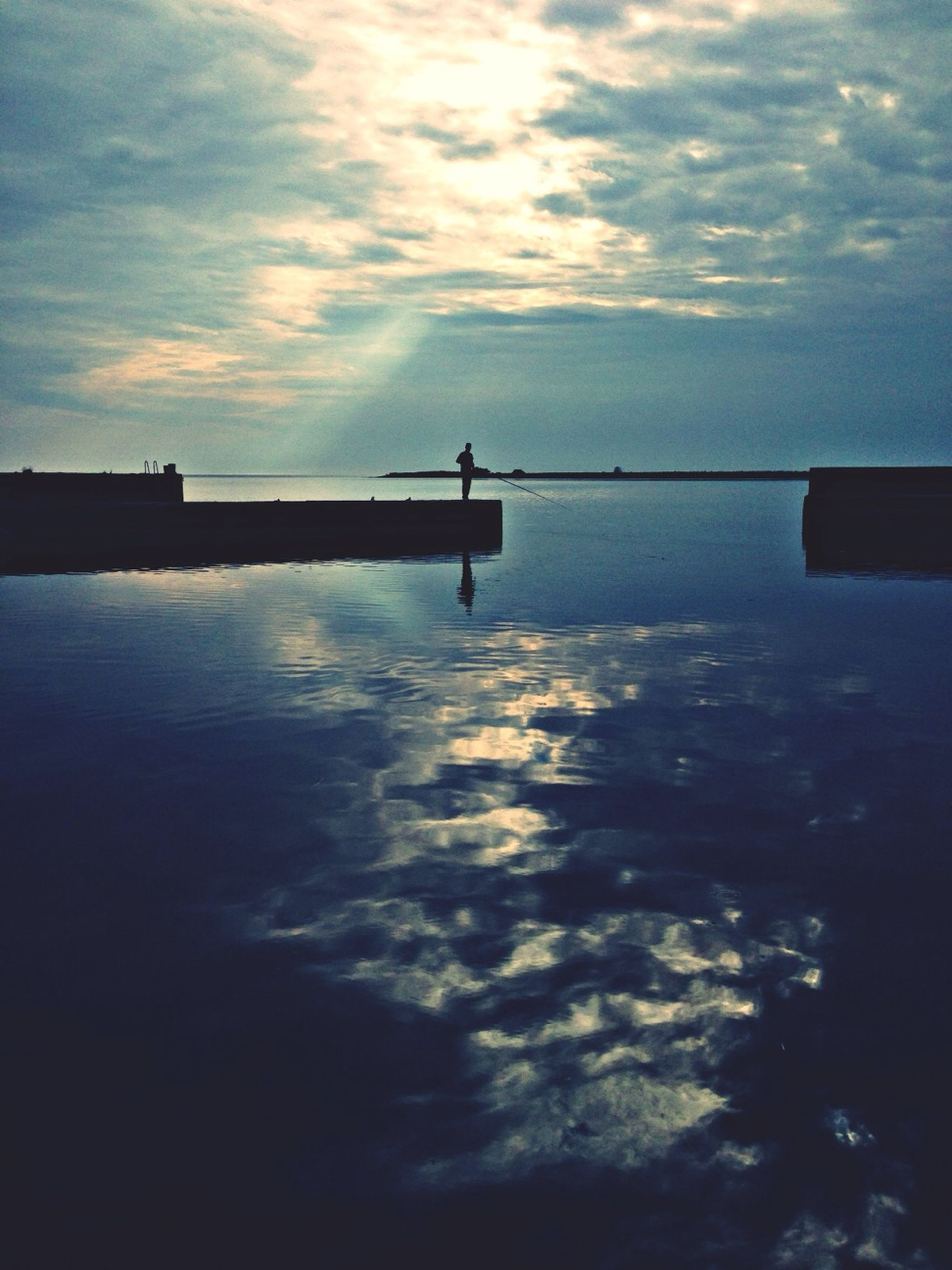 sky, water, sunset, silhouette, sea, cloud - sky, tranquility, tranquil scene, scenics, beauty in nature, reflection, horizon over water, nature, cloud, idyllic, cloudy, waterfront, calm, dusk, lake