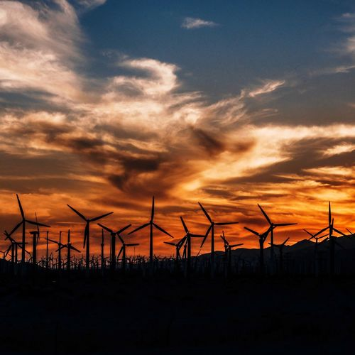 Wind mills at sunset in Palm Springs, CA Sky Sunset Cloud - Sky Silhouette Environment Nature Fence Beauty In Nature Scenics - Nature Orange Color Land No People Fuel And Power Generation Tranquil Scene Tranquility Environmental Conservation Renewable Energy Technology Outdoors