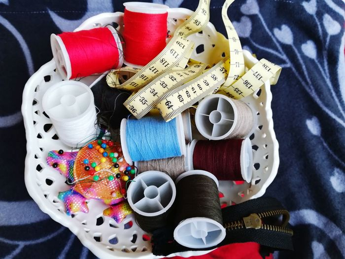 Close-up of colorful sewing items on table
