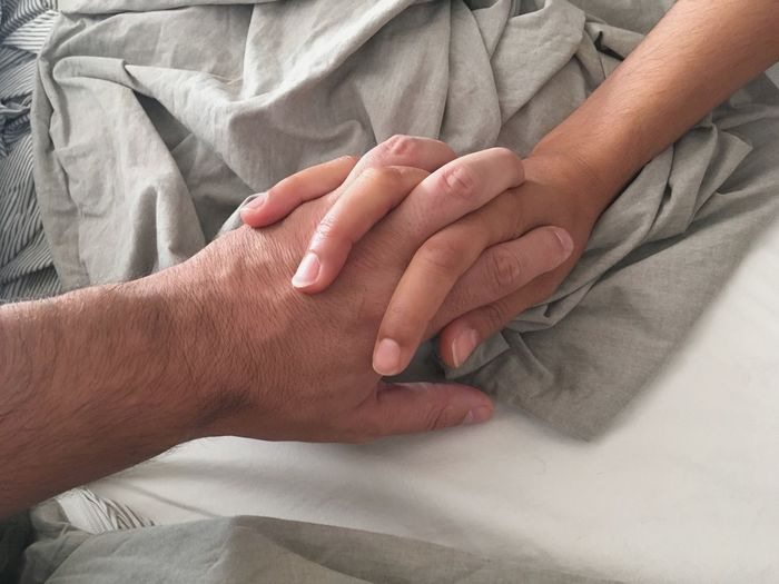 Human Hand Human Body Part Hand Body Part Adult Finger Women Touching Two People Human Finger Bed Indoors  Togetherness People Men Furniture Close-up Lifestyles Positive Emotion Love