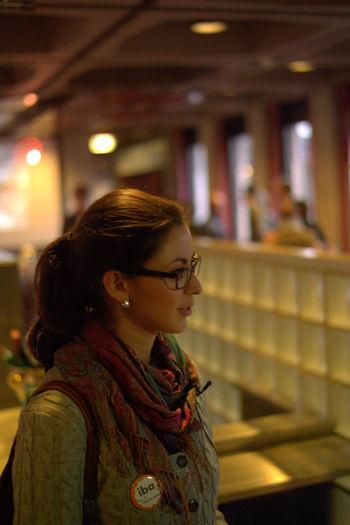 Woman Looking Away In Illuminated Temple