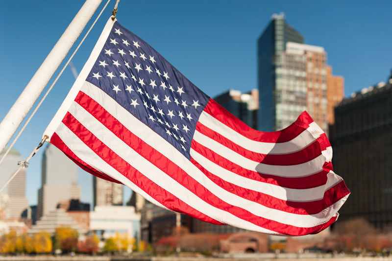 Close-Up Of American Flag Against Blue Sky