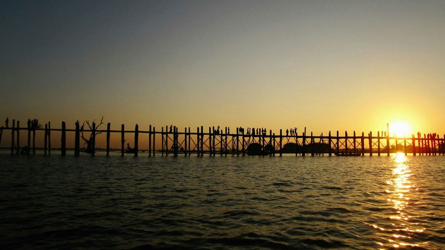Silhouette U Bein Bridge Over Lake Against Sky During Sunset
