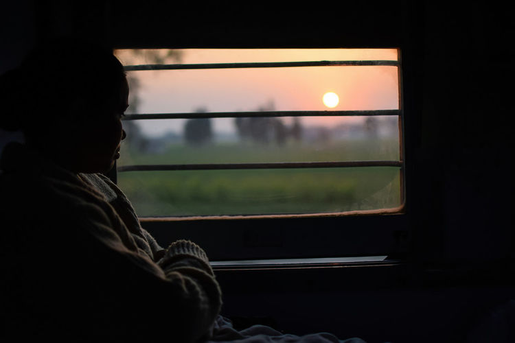 Woman Traveling On Train