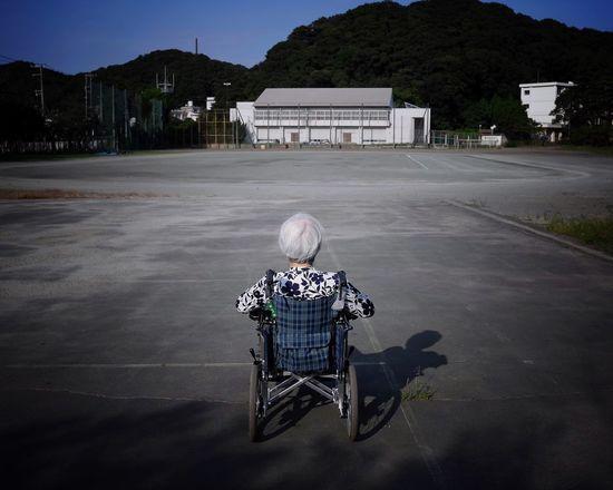 Wheelchair Rear View Senior Adult Senior Women Transportation Sitting Playgrounds Schoolyard