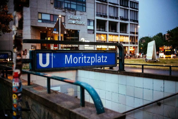 Information sign on bridge in city