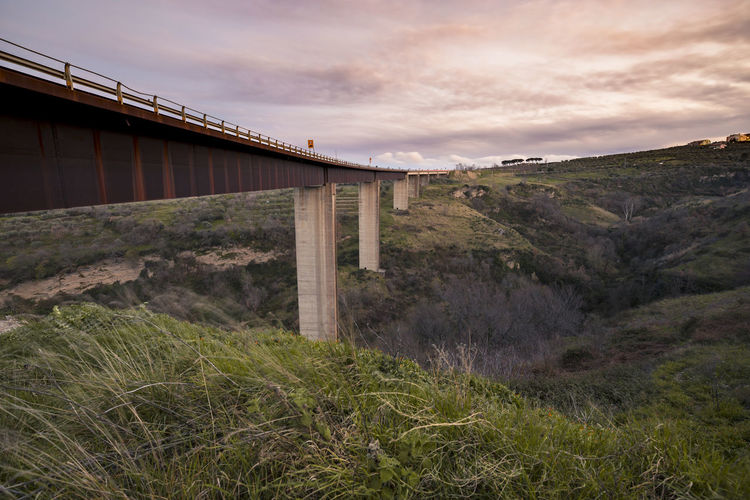 Pilons under road to sunset higway to the sun highway spring springtime Colors Stories from the City Higway To The Sun Highway Spring Springtime Colors Basilicata Vulture Architecture Sky Bridge - Man Made Structure Suspension Bridge Engineering