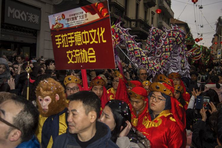 Chinese New Year 2018 Traditional Culture Celebration Chinatown Milan City Communication Crowd Day Large Group Of People Lifestyles Men Outdoors People Real People Text Togetherness Unity Women