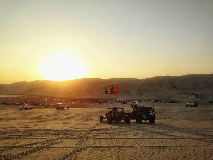 Sport Utility Vehicle On Desert At Sunset