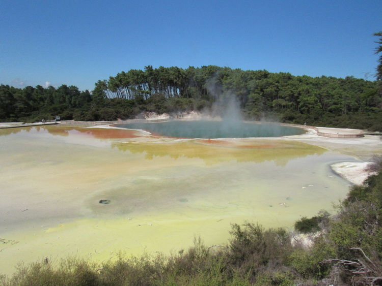 EyeEmNewHere New Zealand Wai O Tapu Champagne Champagn Lake Tourism Tourist Attraction  Travel Travel Destinations Must See Destination Water Hot Spring Spraying Heat - Temperature Motion Sky Landscape Geology Lake Steam