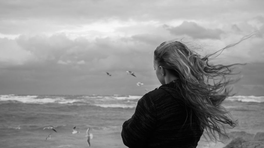 Girl of the sea Hair Beach Birds Cloud - Sky Clouds Comfy  Feelings Feels Girl Glarus Long Hair Motion Nature Ocean One Person Outdoors Pullover Sad Sea Sky Sweatshirt Water Wind Window Women Be Brave EyeEmNewHere