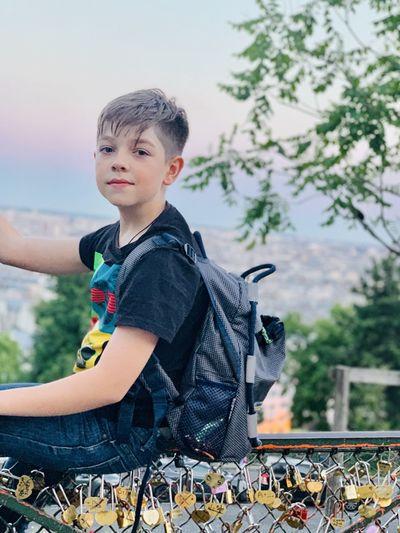 Portrait of boy looking away outdoors
