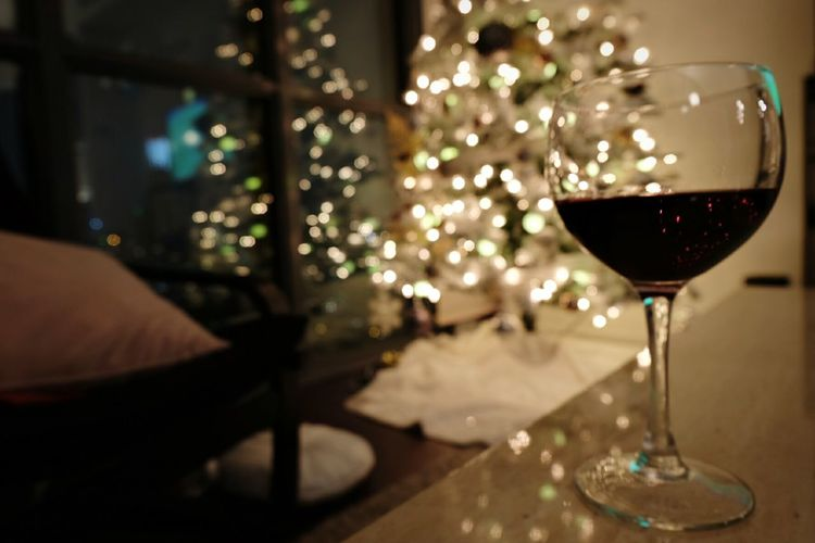 Kicking back with a glass of red Wine Red Wine Hanging Out Relaxing Christmas Tree Christmas Lights
