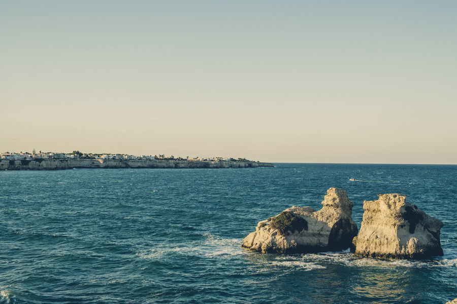 Two Sisters - Melendugno . Lecce - Italy Beach Beachphotography Beauty In Nature Clear Sky Coast Day Horizon Over Water Italy Nature No People Outdoors Rocks Rocks And Water Salento Salento Puglia Sea Sea And Sky Sea View Sky Sunset Tranquil Scene Tranquility Tranquility Water Waves, Ocean, Nature
