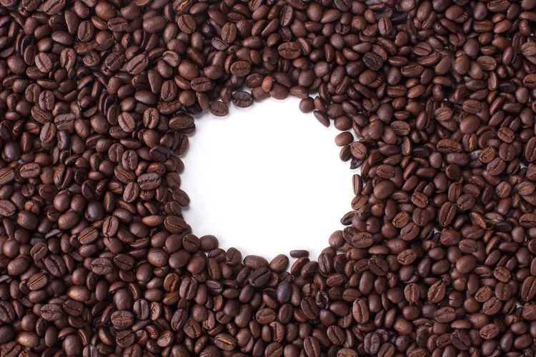 Close up Ceramic blue bowl isolated on white background shoot in the studio with space for copy. Coffee Caffeine Brown Bean Drink Dark Beverage Seed Roasted Food Background Black Espresso Cafe Isolated White Natural Aroma Closeup Breakfast Ingredient Morning Mocha Grain Energy Cappuccino Arabic Roast Hot Gourmet Fresh Crop  Space Group Macro Coffe Texture Color Design Freshness Vector Aromatic Agriculture Nobody Object Shop Abstract Retro Wallpaper Top