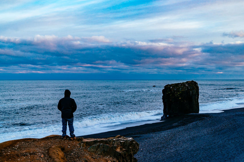 Beach Beauty In Nature Cloud - Sky Full Length Horizon Over Water Iceland Island Leisure Activity Lifestyles Men Rear View Rock - Object Scenics Sea Silhouette Sky Standing Tranquil Scene Tranquility Water