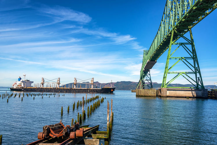 View of the Astoria Megler Bridge in Astoria, Oregon with a tanker ship about to pass beneath it Astoria Oregon Pacific Northwest  Columbia River River Travel Travel Destinations Tourism Astoria-megler Bridge Bridge Transportation Sky Architecture Built Structure Blue Day Outdoors Water Nature Nautical Vessel Mode Of Transportation Pier No People Harbor Tanker Tanker Ship Ship Shipping