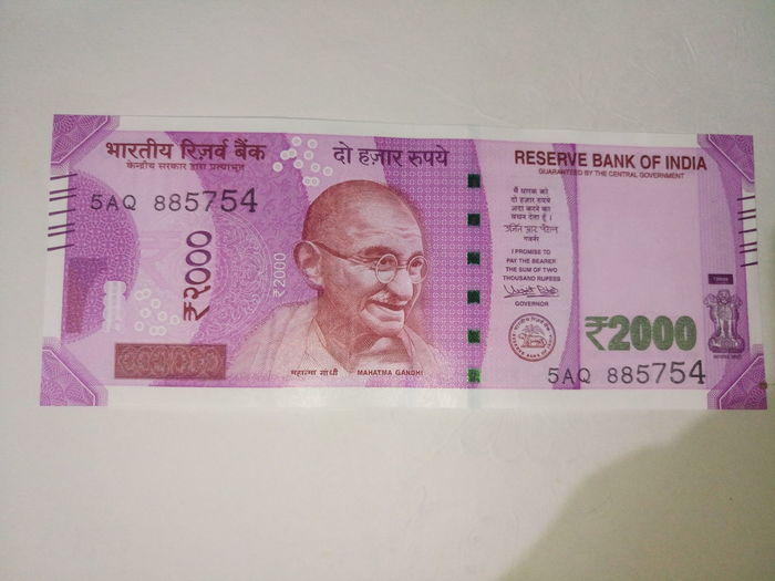Indian two thousand rupee note 2000 Banknote Business Computer Monitor Currency Indian Finance Finance And Economy Indian Culture  Indian Currency Indian Two Thousand Rupee Note Mature Adult Mature Men Men New One Man Only One Mature Man Only Only Men Paper Currency Pink Color Savings Success Text Two Thousand Rupee Note Wealth Working