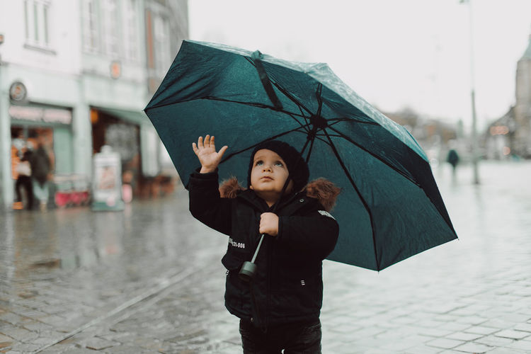 Boy with his umbrella playing