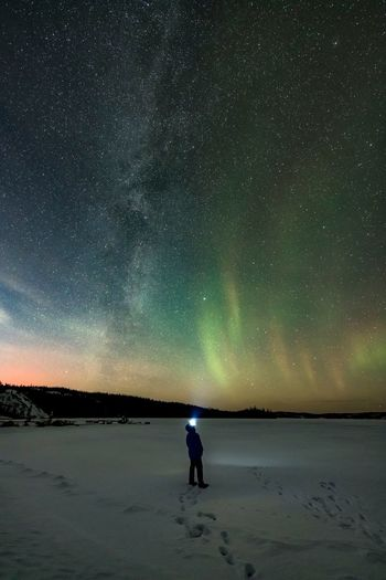 Northern lights Star - Space Night Astronomy Sky Space Beauty In Nature Scenics - Nature Nature Star Field Tranquil Scene Tranquility Standing One Person Water Space And Astronomy Star Men Land Milky Way Galaxy