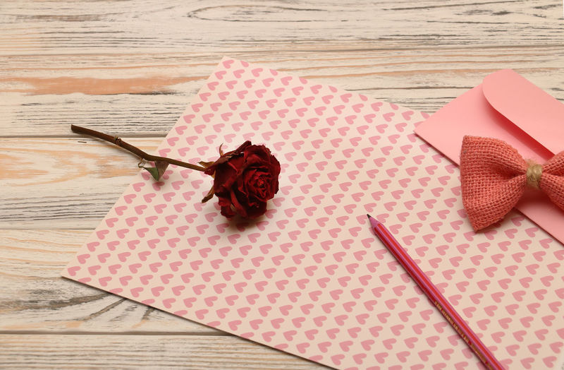 Happy Valentines Day ;) Copy Space Sentimental Table Wood - Material High Angle View Pattern No People Still Life Pink Color Indoors  Creativity Directly Above Envelope Valentine's Day  Pages Dry Rose Pencil Write A Letter Love Letter Postage Stamp Pencil Sharpener Valentine Card