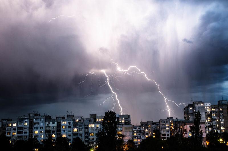 Lightning in sky over city