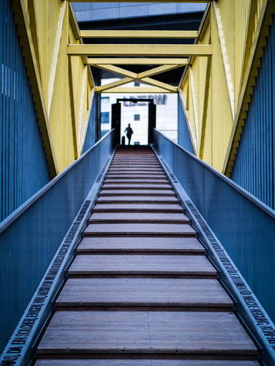 Baden-Württemberg  Landesbank Stuttgart Architecture Bridge Bridge - Man Made Structure Built Structure Connection Diminishing Perspective Direction Europaviertel Lbbw One Person person Railing Staircase Steps And Staircases The Way Forward Yellow
