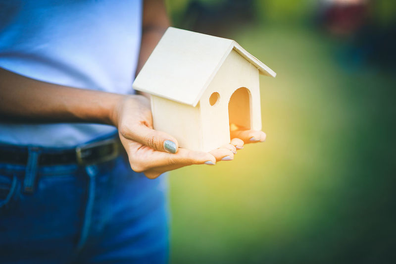 Architecture Building Building Exterior Built Structure Casual Clothing Close-up Day Focus On Foreground Hand Holding Home Ownership House Human Body Part Human Hand Midsection One Person Outdoors Real People Standing
