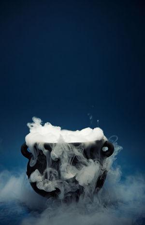 Spooky Halloween magic potion cauldron. Halloween Holiday Smoke Witchcraft  Cauldron Fog Magic Potion Potion Spooky